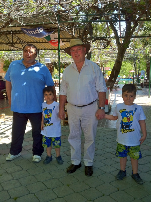Muzzy, his two sons and author of the novel 'Birds Without Wings', Louis de Bernieres earlier this year in Kayaköy